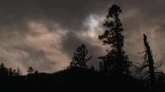 Full moon behind eerie clouds Stock Footage