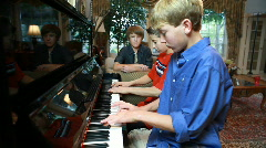 Two boys playing piano Stock Footage