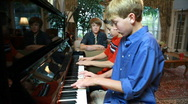 Stock Video Footage of two boys playing piano