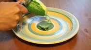 Stock Video Footage of Peeling Cucumber on a Plate