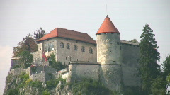 Bled Castle high above Lake Bled in Slovenia Stock Footage