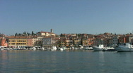 Stock Video Footage of Track passed boats moored in the harbor at Rovinj Croatia.