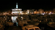Stock Video Footage of Boats moored in the harbor at Rovinj Croatia at night.