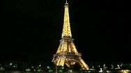 Stock Video Footage of Eiffel Tower at Night with Sparkling Stars