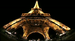 Eiffel Tower at Night with People Moving in Background  - stock footage