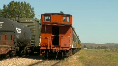 Railroad, caboose, freight and passenger cars on siding Stock Footage