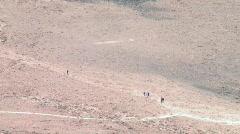 People Walking in the Desert Stock Footage