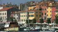 Fishing boats moored in the harbor at Rovinj Croatia. Stock Footage