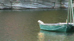 Rowboat floats peacefully Stock Footage