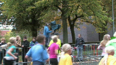 Cameraman filming a footrace Stock Footage