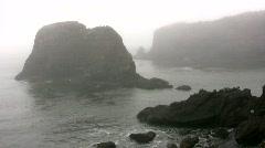 Rocky coast shrouded in mist and fog Stock Footage