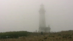 Lighthouse in fog Stock Footage