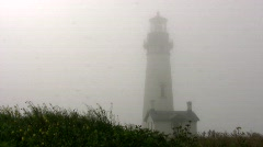 lighthouse in windy fog Stock Footage