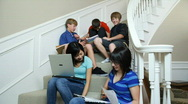 Stock Video Footage of teenagers studying on stairs