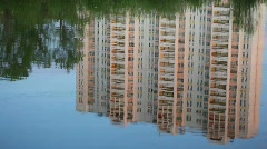 Building reflected in water Stock Footage