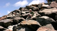 Stock Video Footage of brave boy climbing down boulders