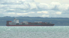 Container ship off shore Stock Footage