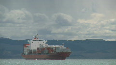 Container ship nears port Stock Footage