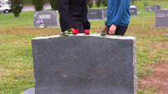 Roses left on tombstone Stock Footage