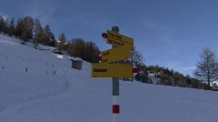 Zoom in trail sign madulain winter Stock Footage