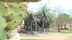 Longhorn with cowboys statue Stock Footage