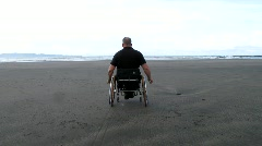 Wounded Veteran in Wheelchair on Beach (HD) Stock Footage
