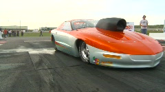 Motorsports, drag racing, burnout in the waterbox Pro Stock firebird Stock Footage
