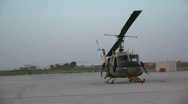 Huey Helicopter parked on runway Stock Footage