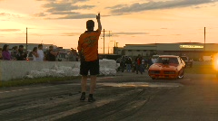Motorsports, drag racing, burnout in the waterbox GTO funnycar sunset pan Stock Footage