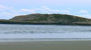 Beach, waves, island on rocky coast Stock Footage
