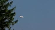 Zeppelin flying in the blue sky Stock Footage