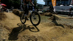 Mountain bikes on dirt track - stock footage