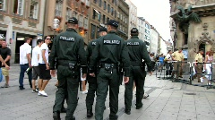 Germany German Police Policemen patrolling city downtown Munich Law and Order Stock Footage