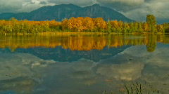 Time Lapse HD 1080p - Clouds Reflection Pond Trees and Mountains in Fall Stock Footage