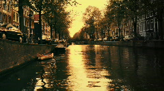 Amsterdam canal city urban boats waterway europe sunset Stock Footage