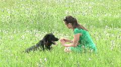 Girl training her dog Stock Footage