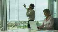 WS MALE AND FEMALE IN OFFICE Stock Footage