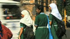 WS school kids in formal dress crossing road Mumbai India Stock Footage