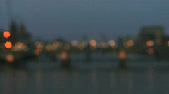 Focus shift on Thames River and traffic on bridge Stock Footage