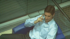 CU MALE SITTING IN CHAIR ON PHONE AND WALKING AWAY Stock Footage