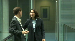 MS MALE AND FEMALE BUSINESS CONVERSATION Stock Footage
