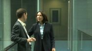 Stock Video Footage of MS MALE AND FEMALE BUSINESS CONVERSATION