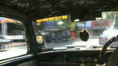 Shot over shoulder on taxi driver Mumbai India Stock Footage