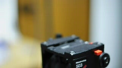 Camera Sliding onto Tripod - stock footage
