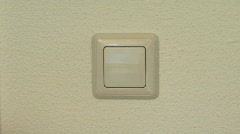 Lightswitch on wall switching on /off Stock Footage