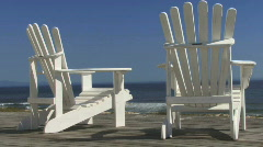Zoom out on relaxing chair and blue sky Stock Footage