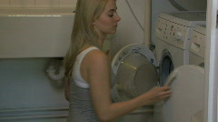 WS OF A YOUNG WOMAN DOING LAUNDRY Stock Footage