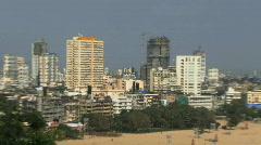 Zoom out of skyline to marine beach mumbai - stock footage