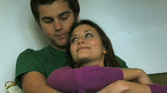 Zoom out on couple cuddling in van Stock Footage