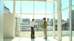 LS WS PAN OF A BUSINESSMAN TALKING TO A CLIENT Stock Footage